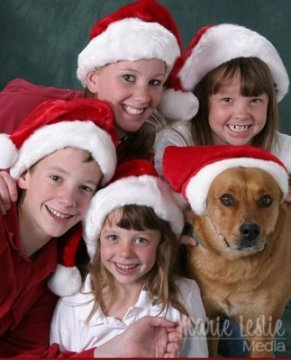children and dog christmas portrait