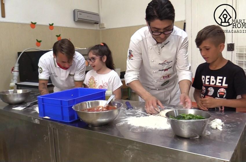 L'arte della pizza insegnata ai bambini: il campo estivo si trasforma in laboratorio