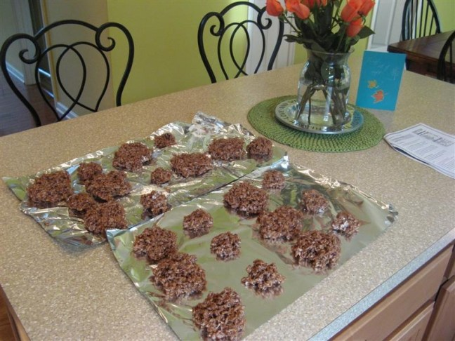 Nathan and I made Rice Krispie Treats to take to our Thanksgiving Feast today. First you make Rice Krispie Treats using Cocoa Krispies. Butter your hands (I forgot this step) and shape them into circles. You'll need a large and small circle for each turkey.