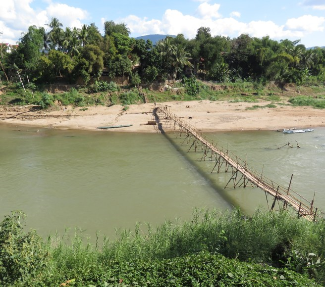 The bamboo bridge across one of the town's two rivers
