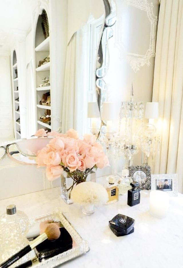 Fresh flowers and pretty bottles complete the look of any vanity dresser. Photo from Tumbler