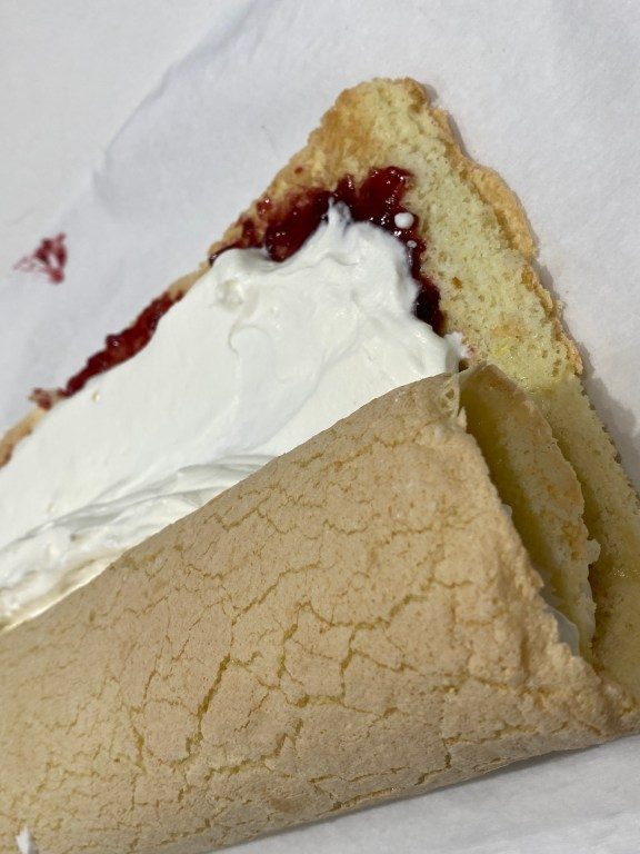 After the jam and whipped cream mis on the cake roll it up!