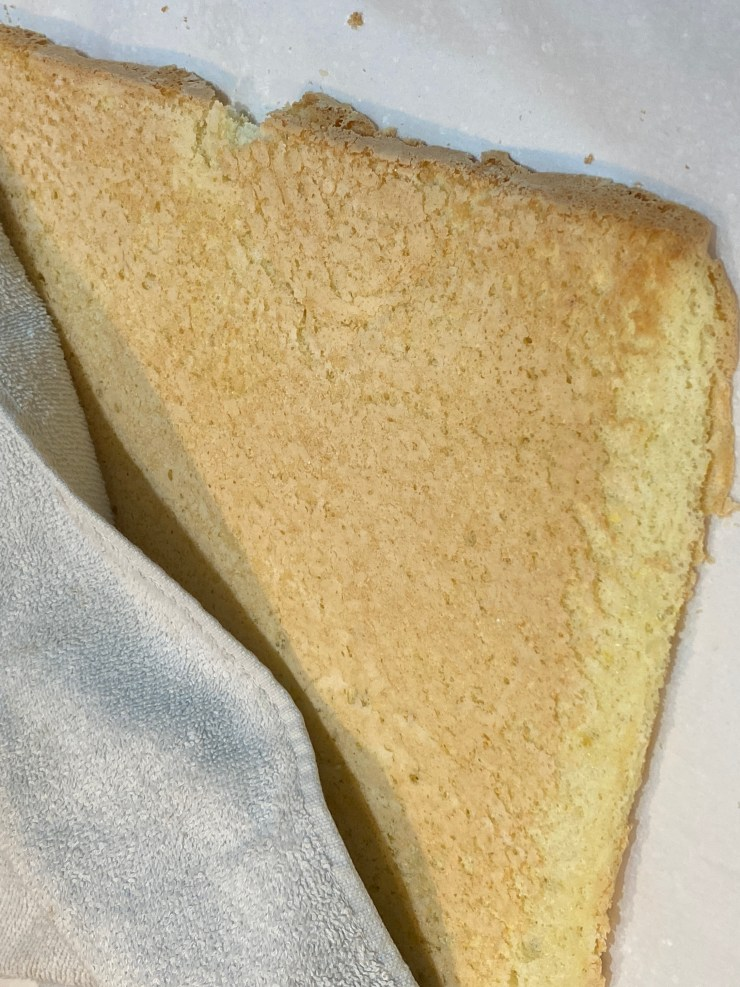 Cover the cake with a towel while the cake cools