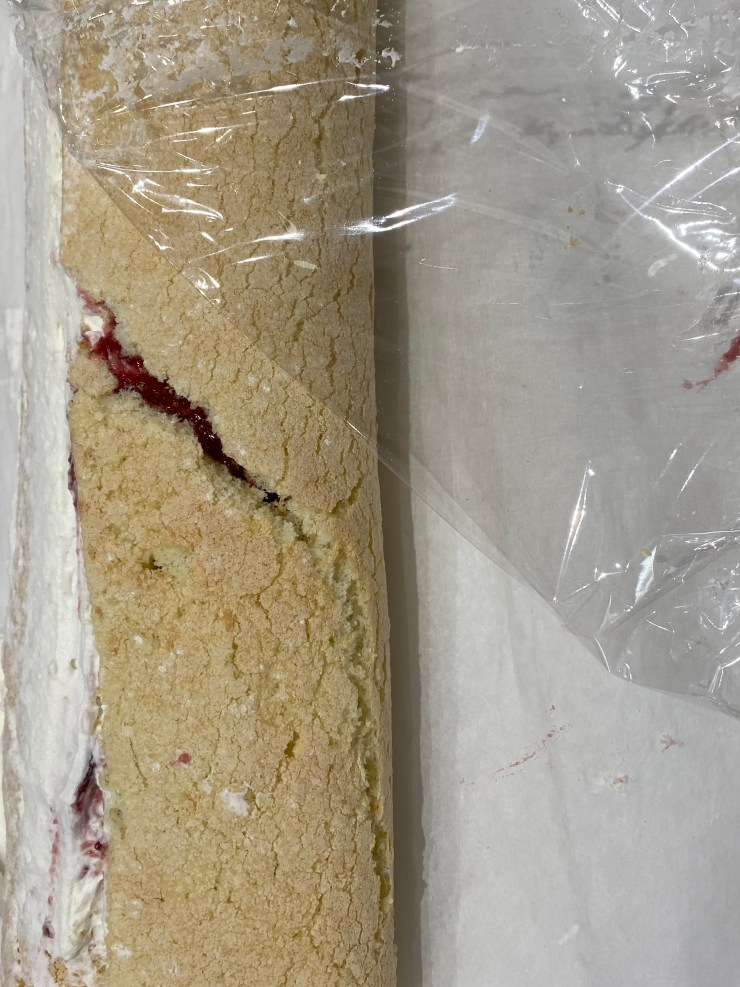 Wrap the rolled cake in plastic wrap
