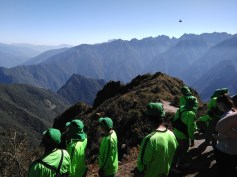 Porters getting a rare break and chance to appreciate the mountains