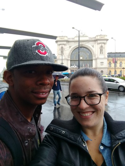In Budapest, with Keleti train station in the background (and rain)