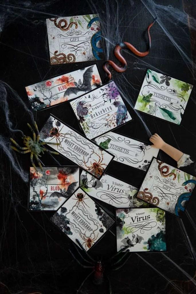 De gratis Halloween etiketter er klippet ud og klar til at lime på flasker.