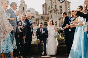 A bride and groom laughs