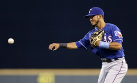 Texas Rangers second baseman Luis Sardinas in action against the Seattle Mariners in a baseball game Sunday, June 15, 2014, in Seattle. (AP Photo/Elaine Thompson)