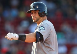 BOSTON, MA - AUGUST 16: Mike Zunino #3 of the Seattle Mariners reacts after knocking in the go ahead run against the Boston Red Sox in the eleventh inning at Fenway Park on August 16, 2015 in Boston, Massachusetts. (Photo by Jim Rogash/Getty Images)