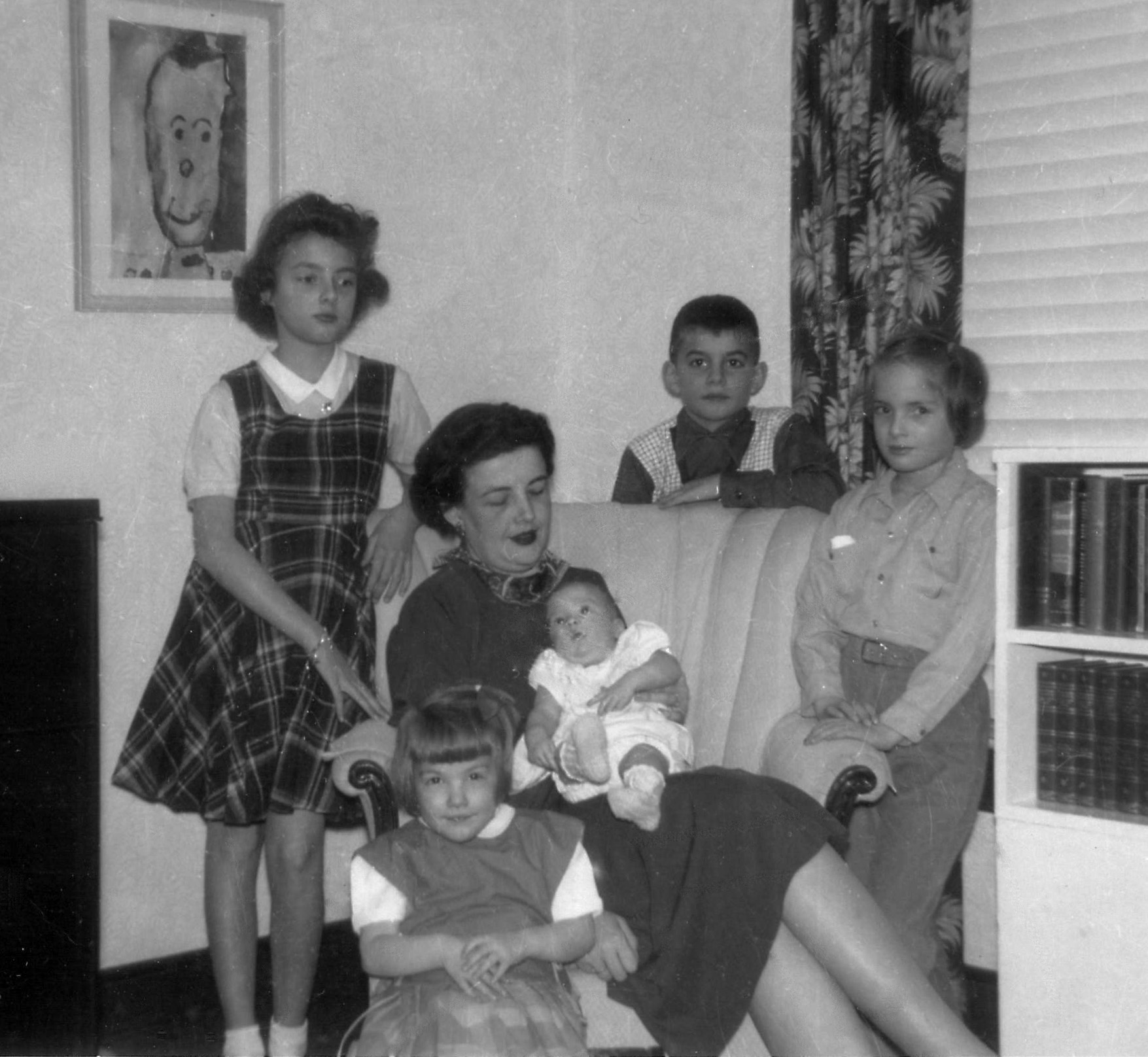 "The name ""Barr Art Association"" was adopted in the fall of 1951, the same fall that my sister, Peggy, was born.  Here Mother (Marion) is pictured with (L to R) Clara, Martha, Peggy, Charles and Helen.  I (Louise) was born in the fall of 1955.  The artwork on the wall was painted by Charles."