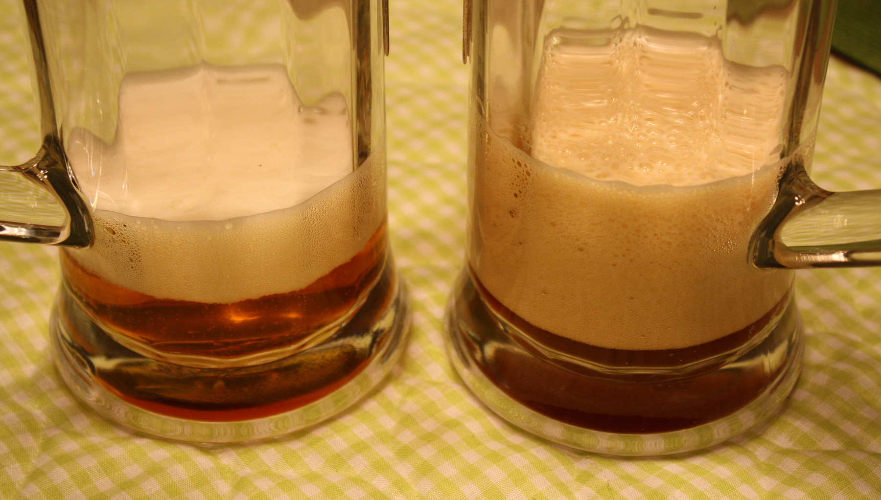 L to R:  Wild Willy's Wheat and Bear Spit.  If you click to enlarge, and then enlarge even a second time, you can see the carbonation bubbles in the Wild Willy's Wheat.  I realize the color isn't exactly the best in this photo, but you can get the idea that Bear Spit is much darker than Wild Willy's Wheat.