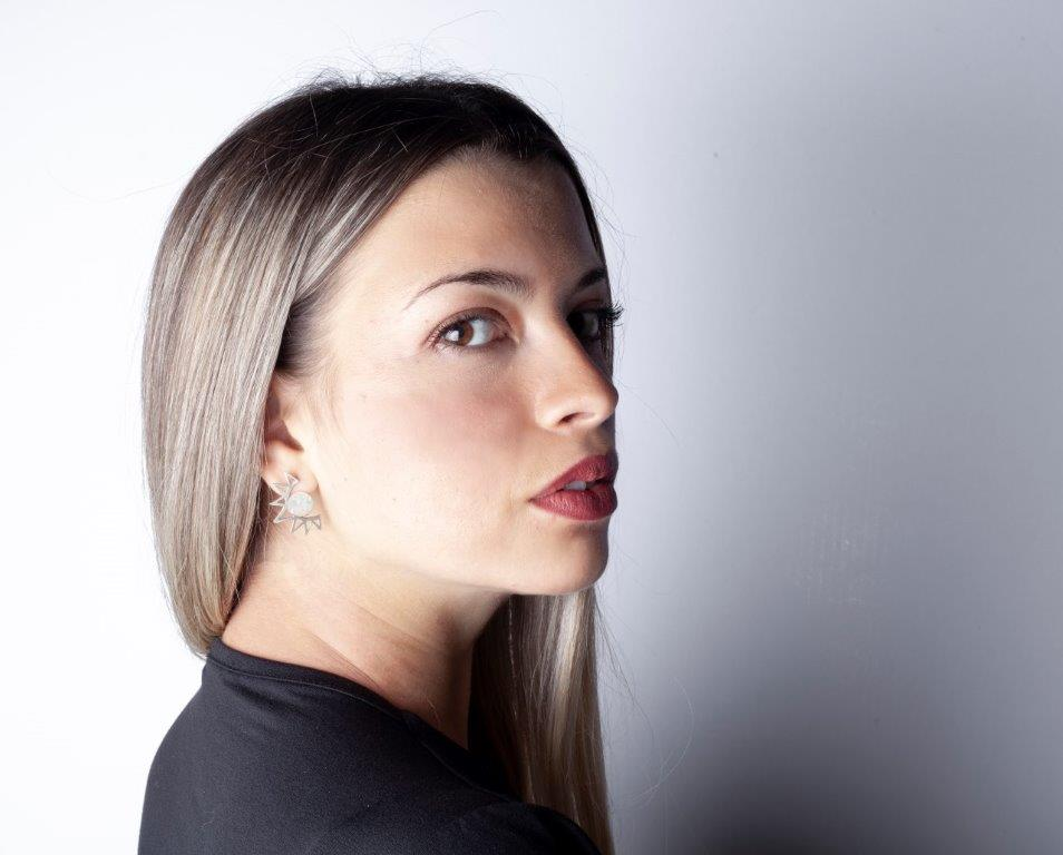 corona-sun-earrings-on-woman