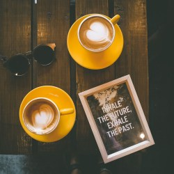 coffee and photo frame on wooden table, six-word stories