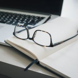 glasses on notebook, resume writing