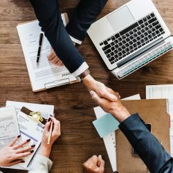 build your business, people shaking hands at table