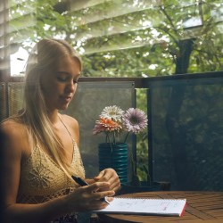 how to cope with stress, woman with paper in covered yard