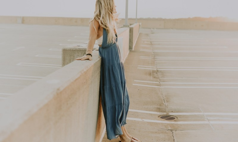 woman on bridge looking outwards, up-side of failure