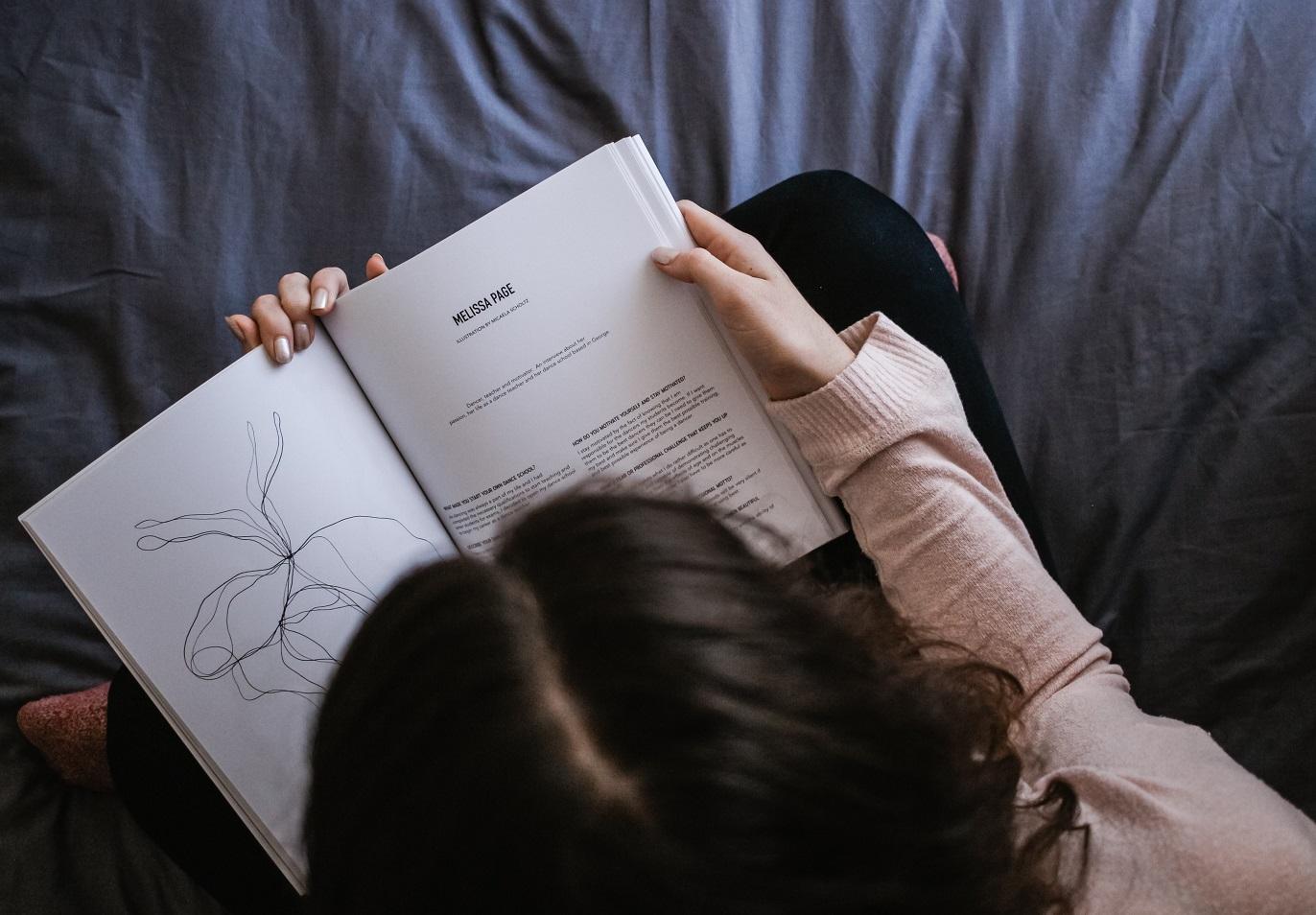 woman reading powerful books by women