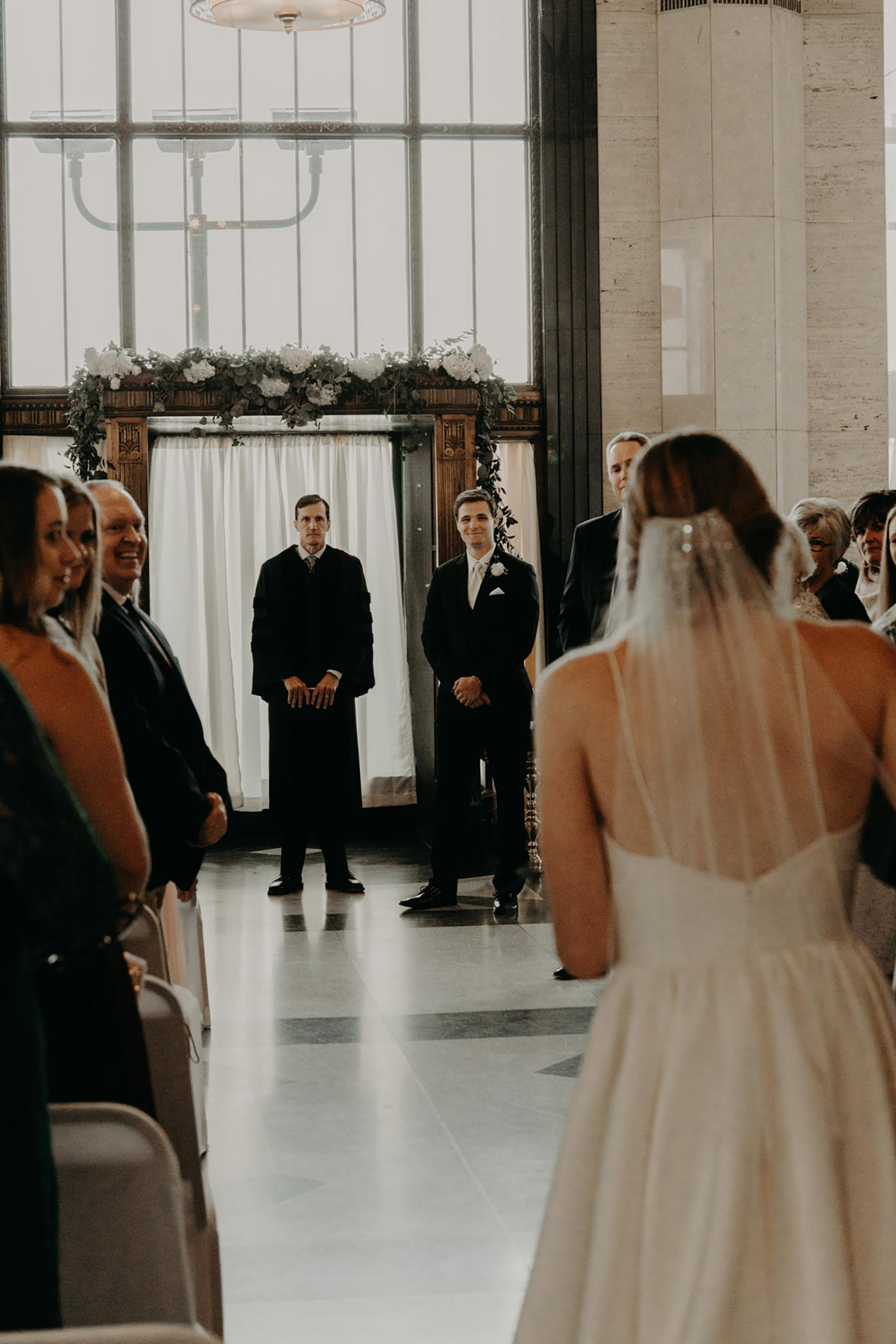 bride walking down aisle to groom
