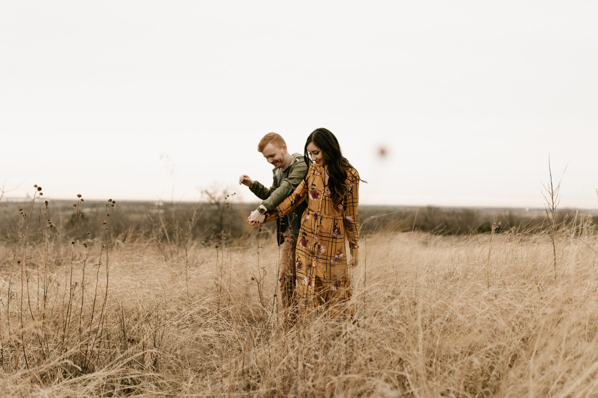 engagement photos in a field in Fort Worth