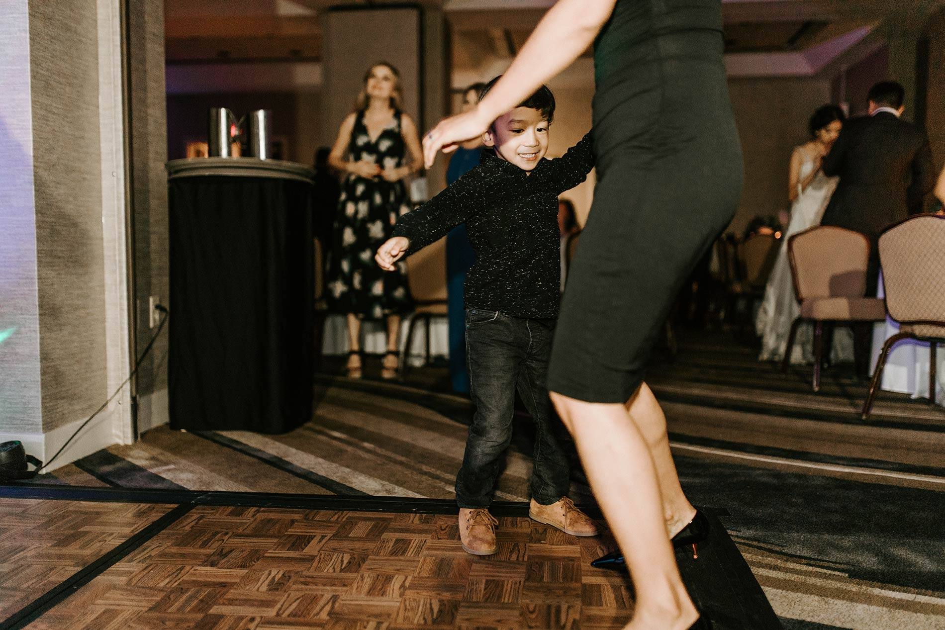 cute kid dancing wedding reception
