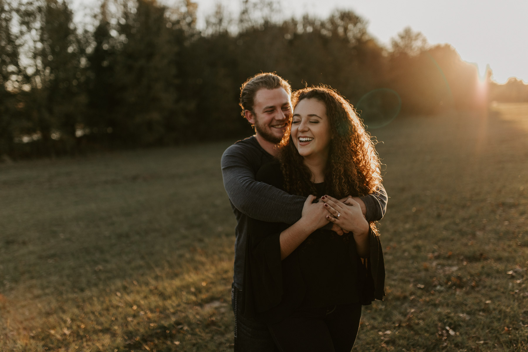 couple cuddling and laughing during their engagement session
