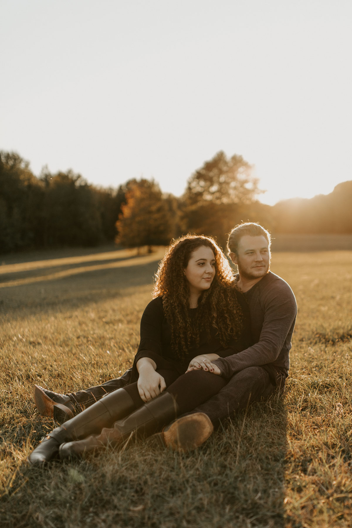 couple sitting in the grass in east Texas