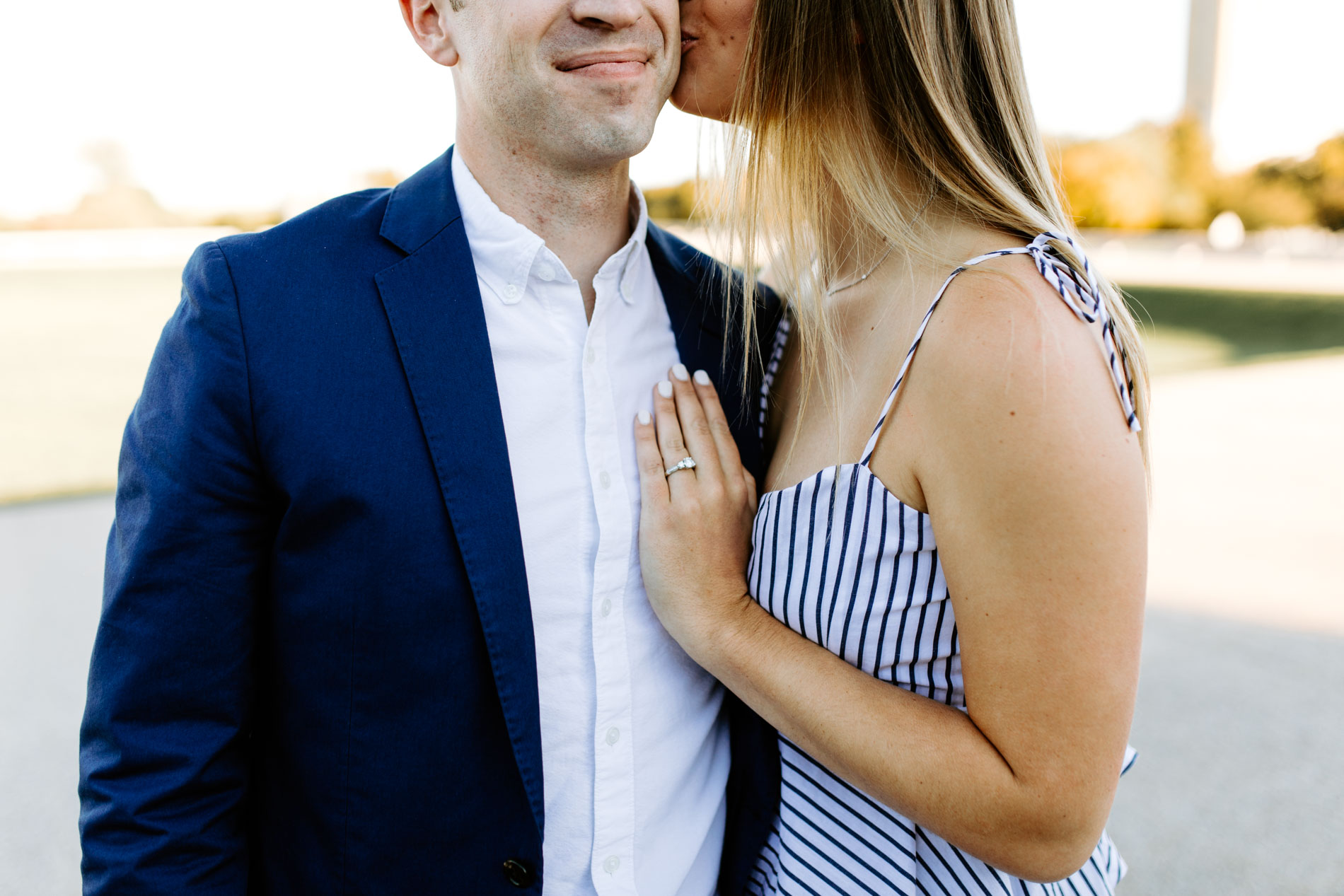 girl kissing boy on cheek for engagement photos