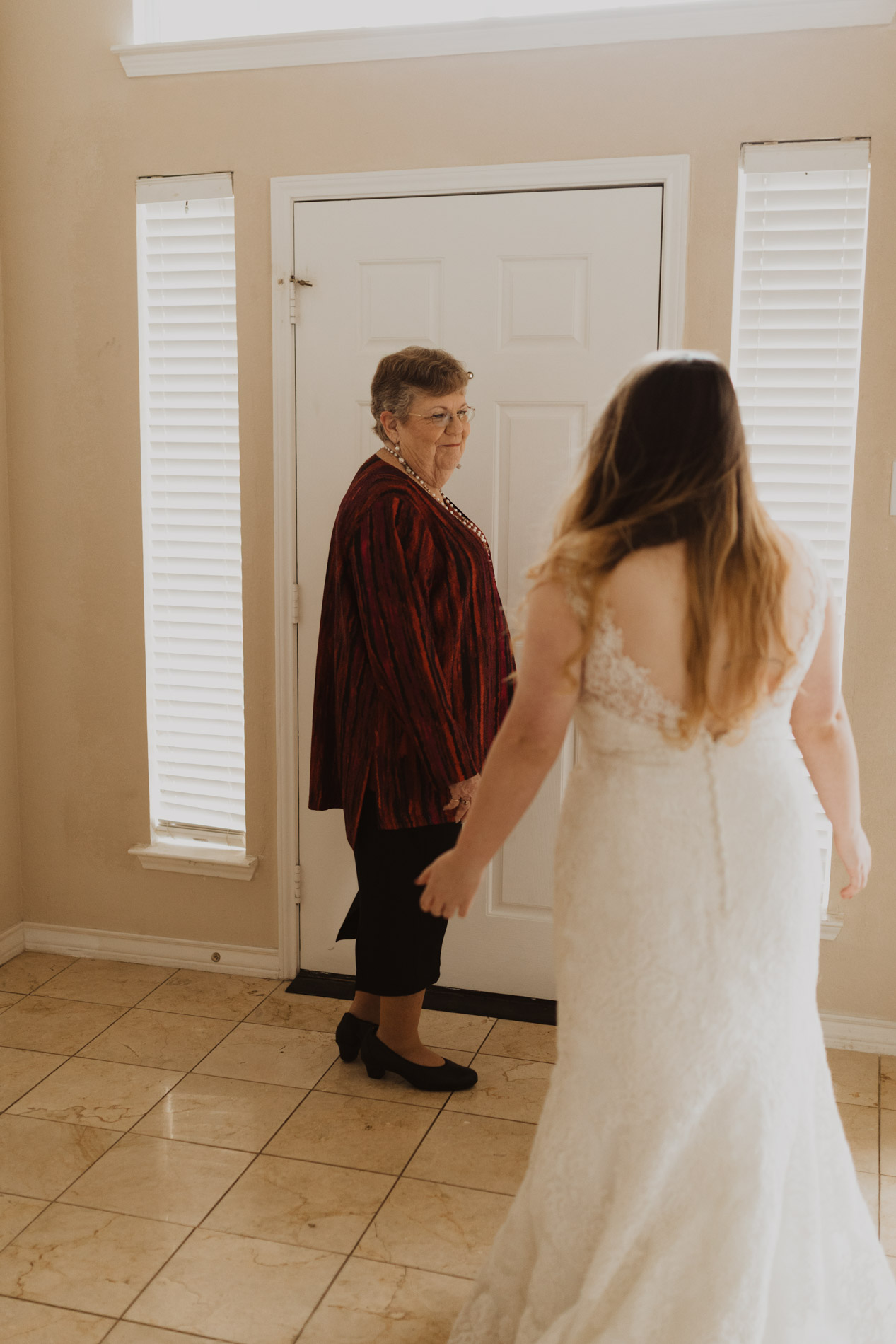 mom seeing daughter for the first time in wedding dress
