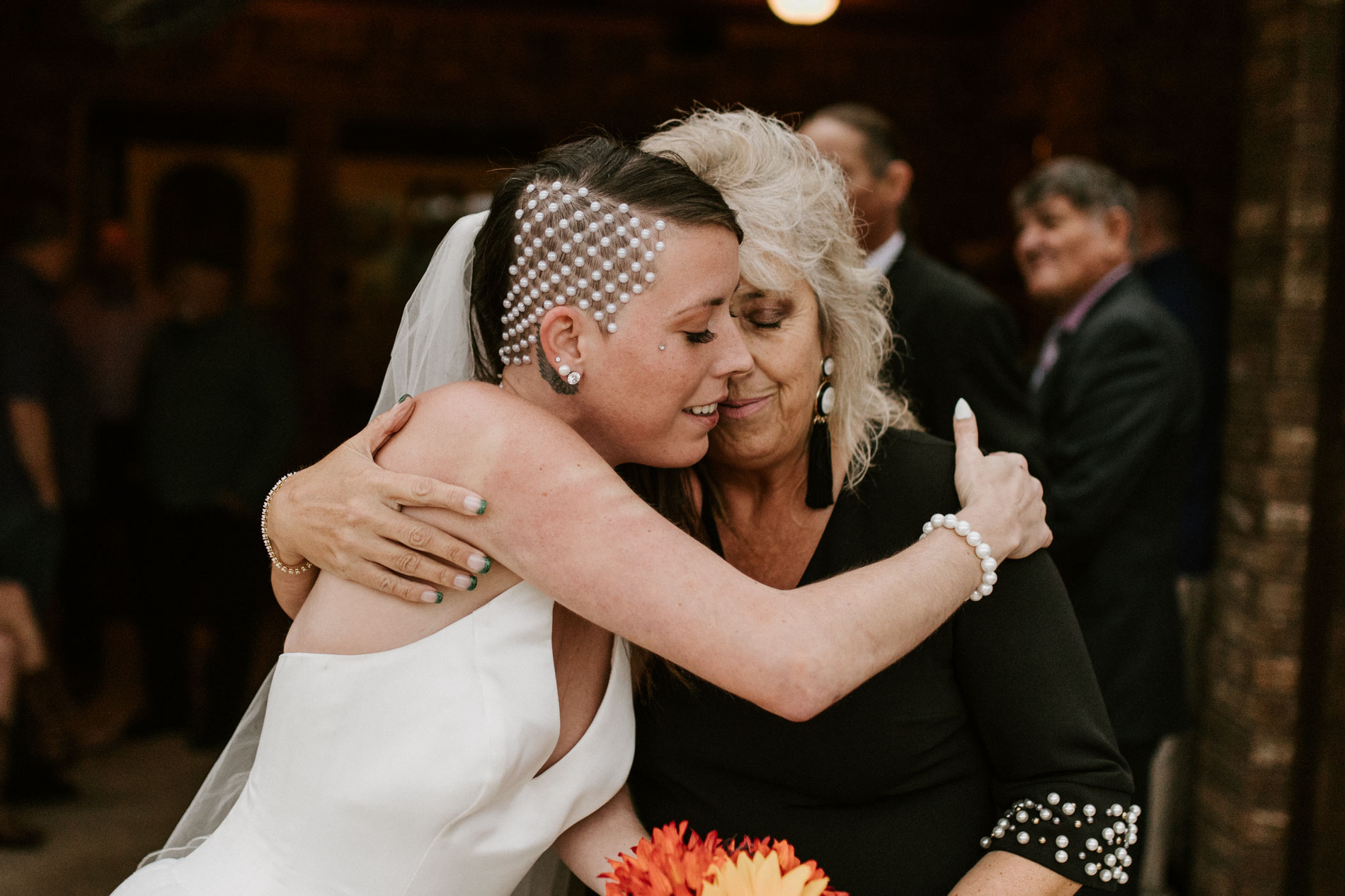 mother daughter touching moment after wedding ceremony