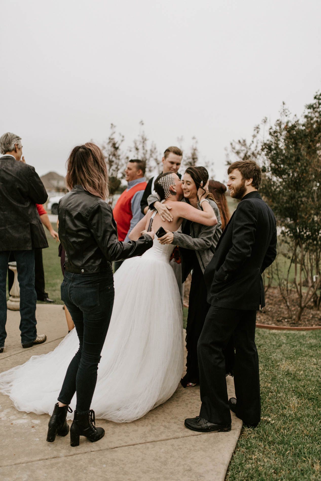 bride greeting guests at wedding reception