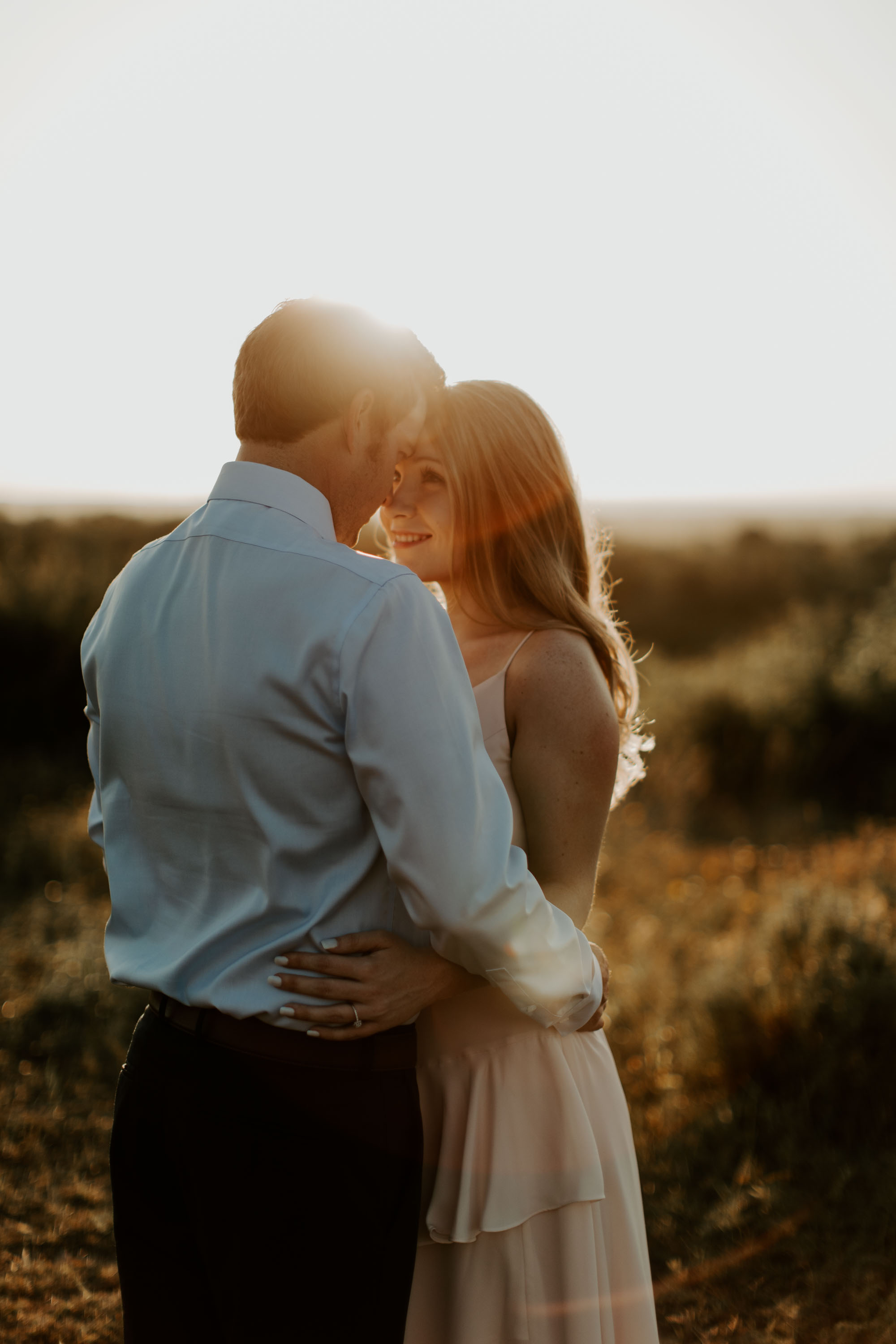North texas couple kissing and hugging at golden hour