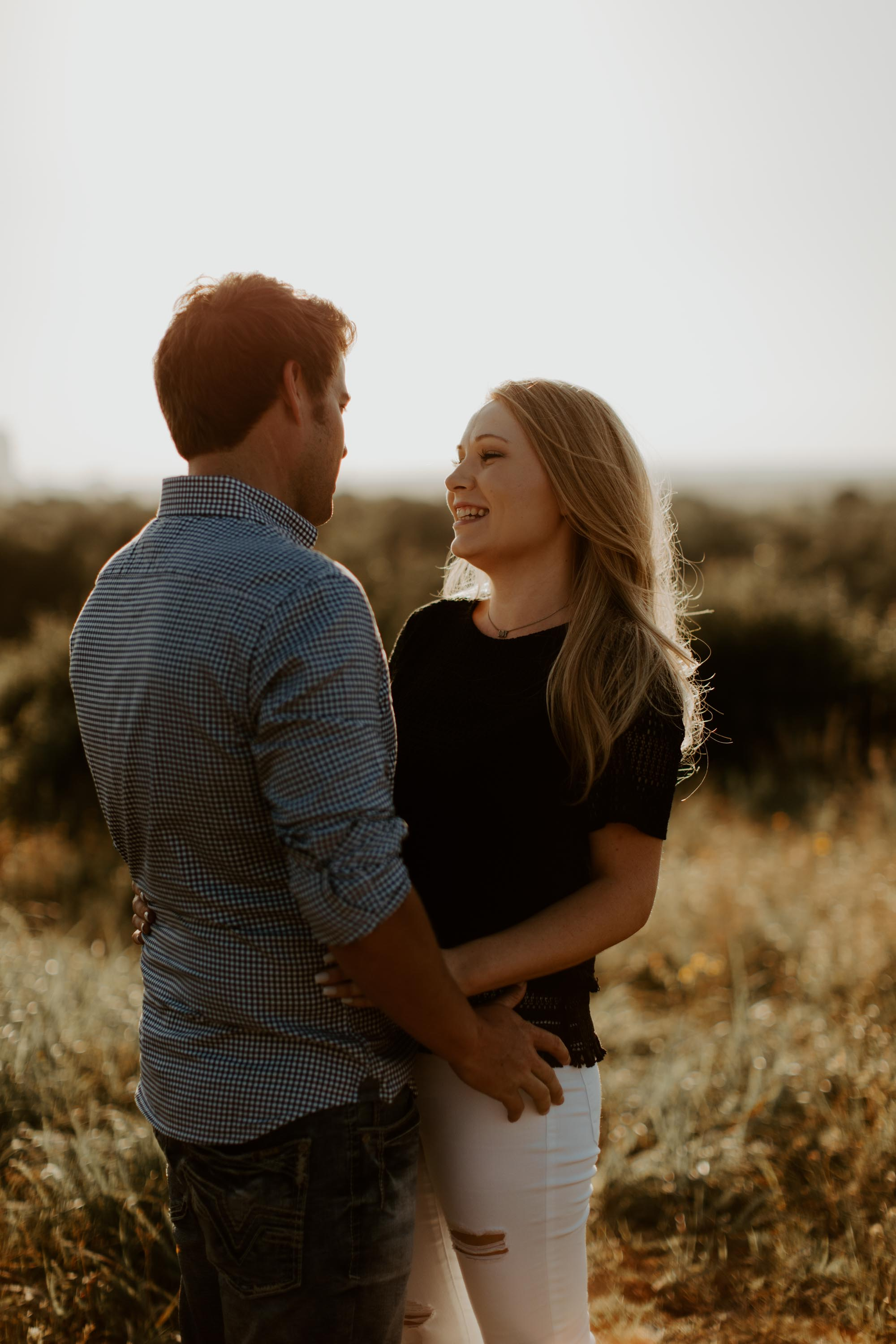 golden hour photo of engaged couple at a park
