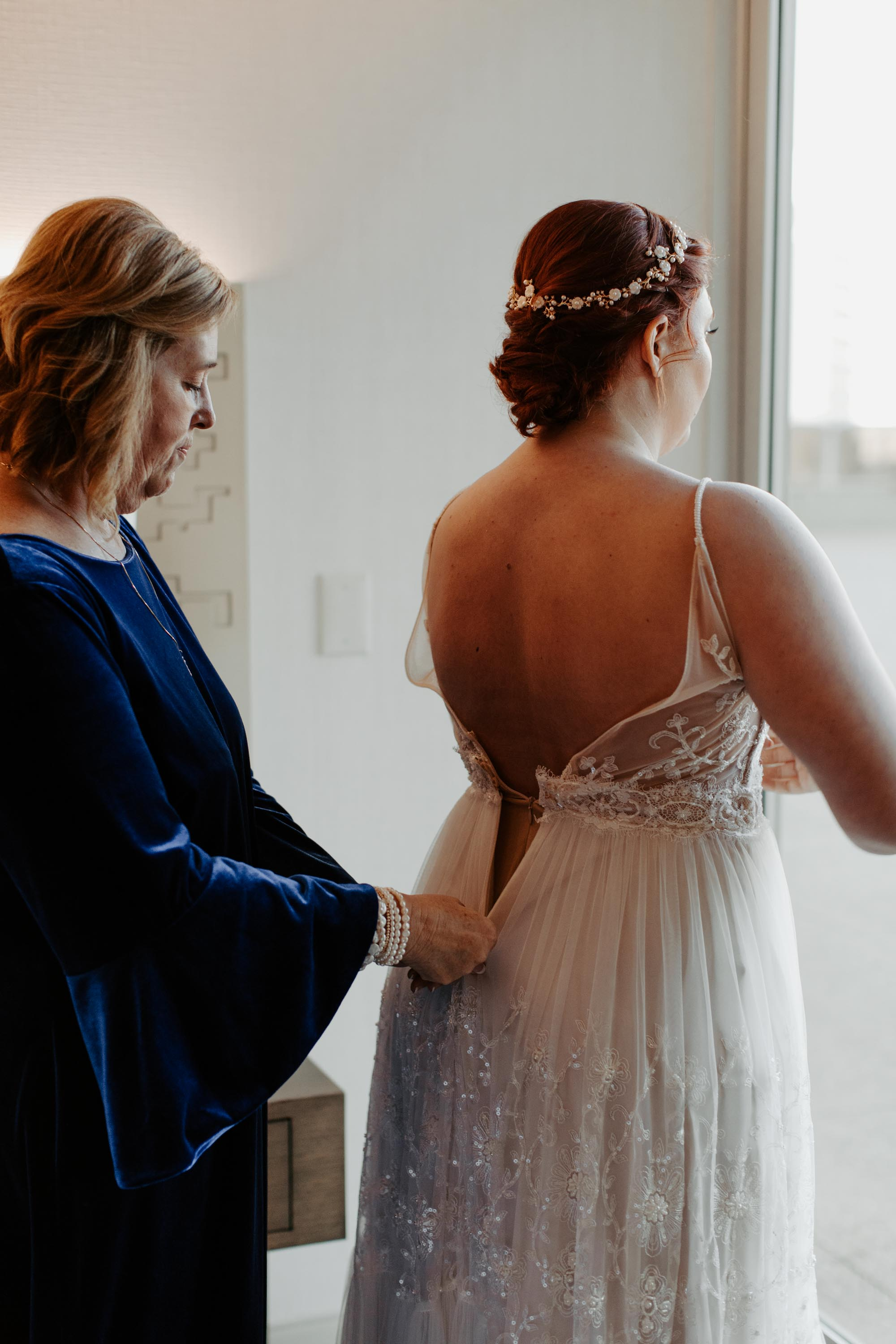 Bride putting on wedding dress on her Dallas TX wedding day