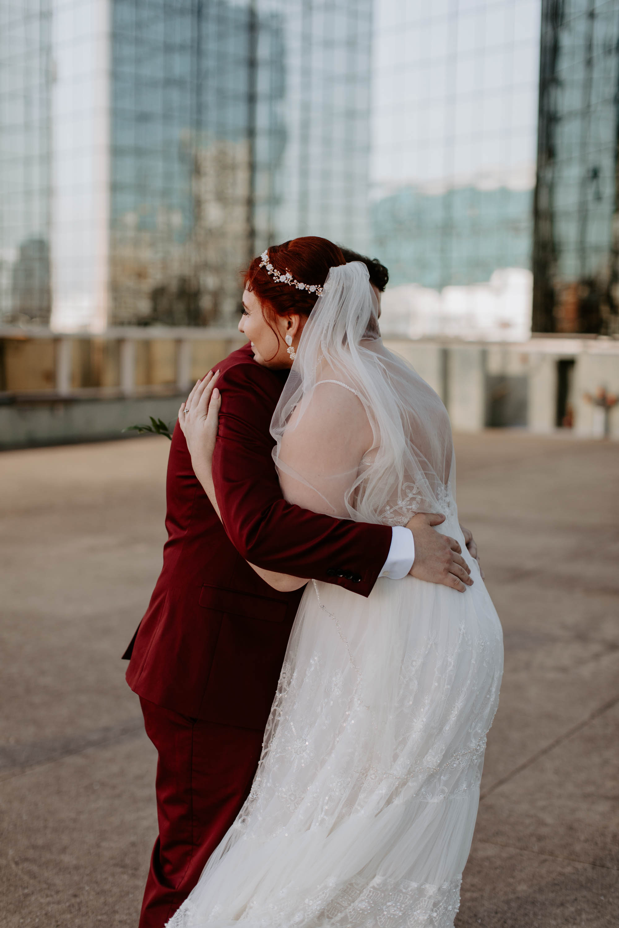 Bride and groom hugging after their first look at reunion tower