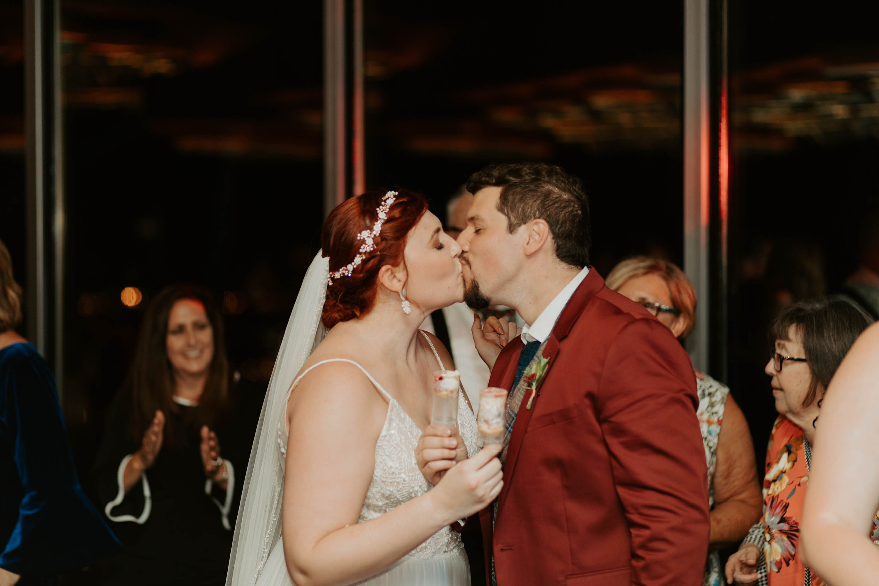 Bride and groom kiss after eating cake
