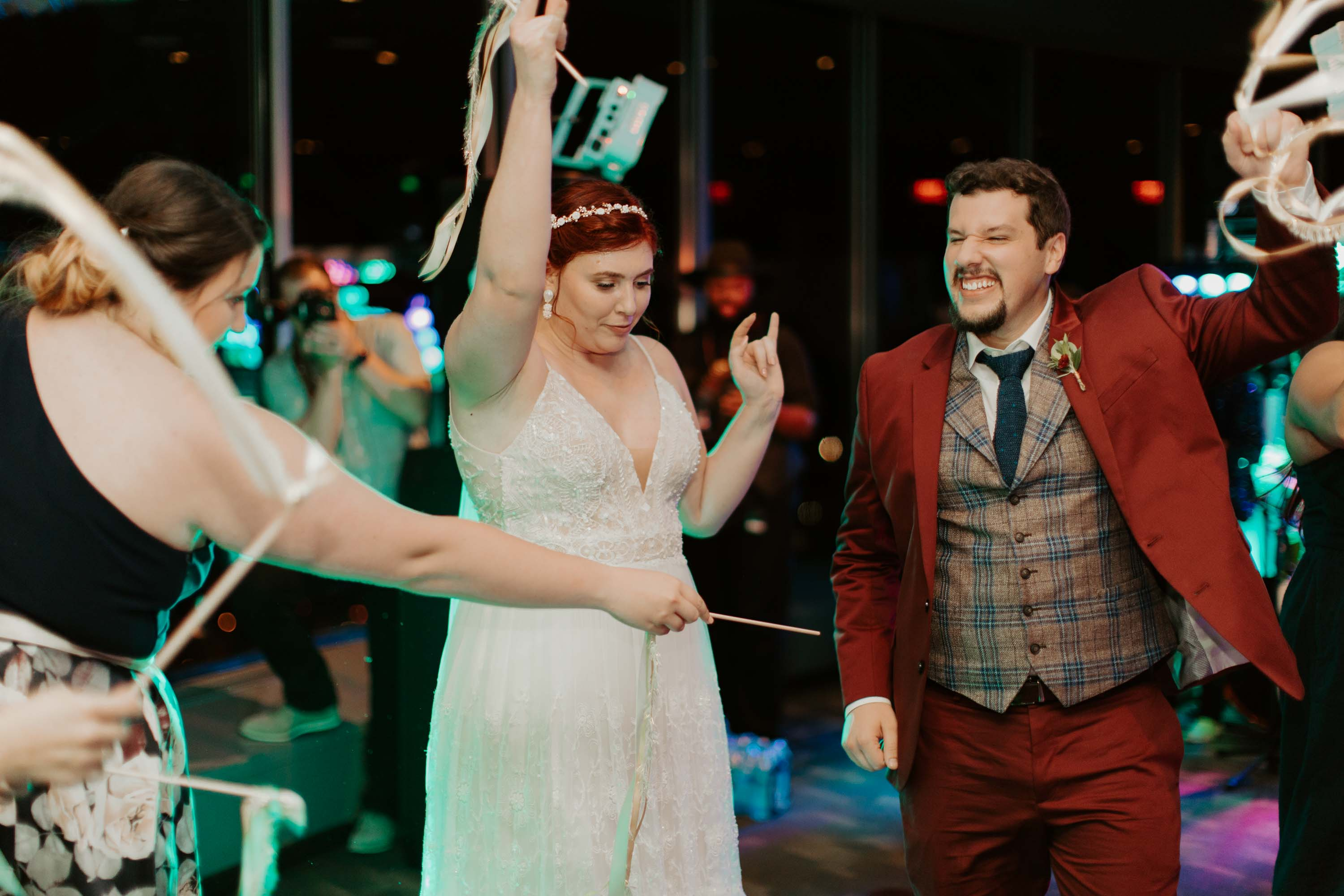 Bride and groom dancing at wedding ceremony in reunion tower