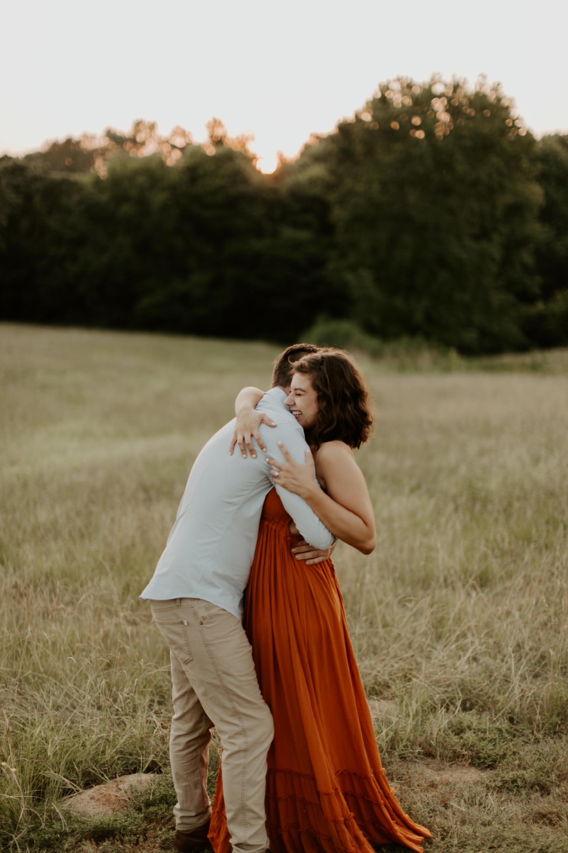 girl hugging boy in field in east texas