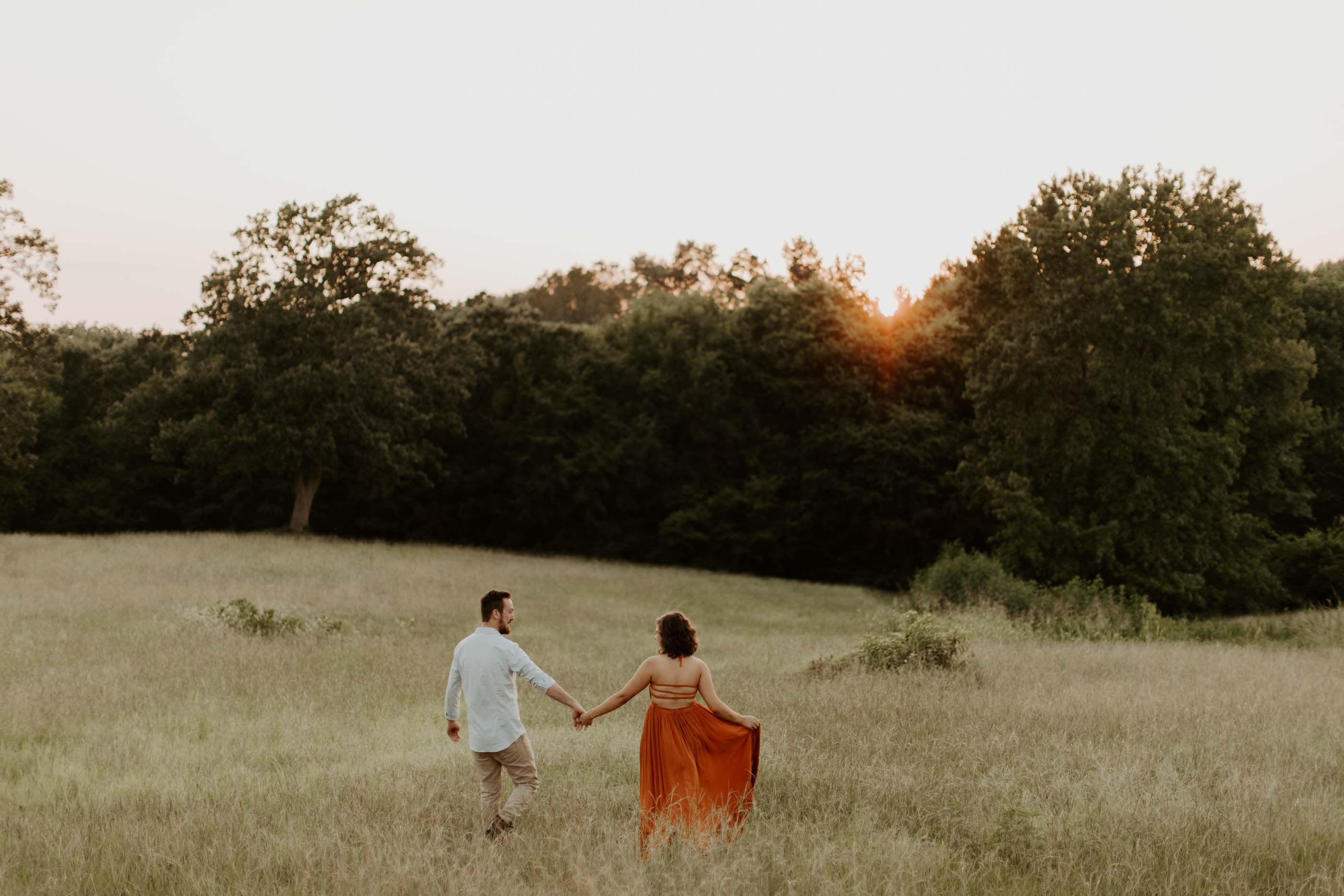 engaged couple holding hands in ETX for engagement session