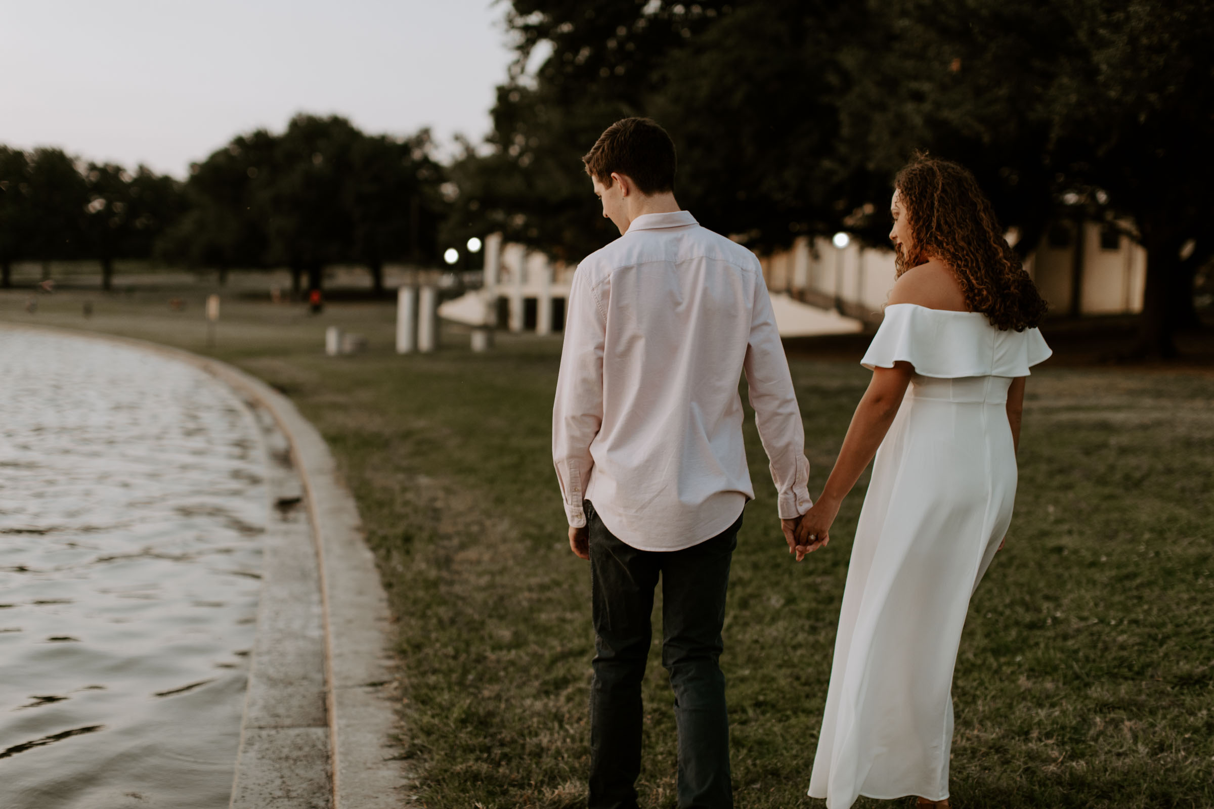 Couple walking and holding hands during their engagement session