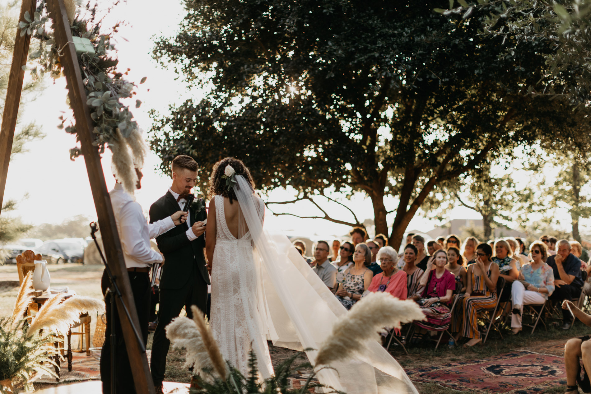 Bride and groom standing at altar infant of guests