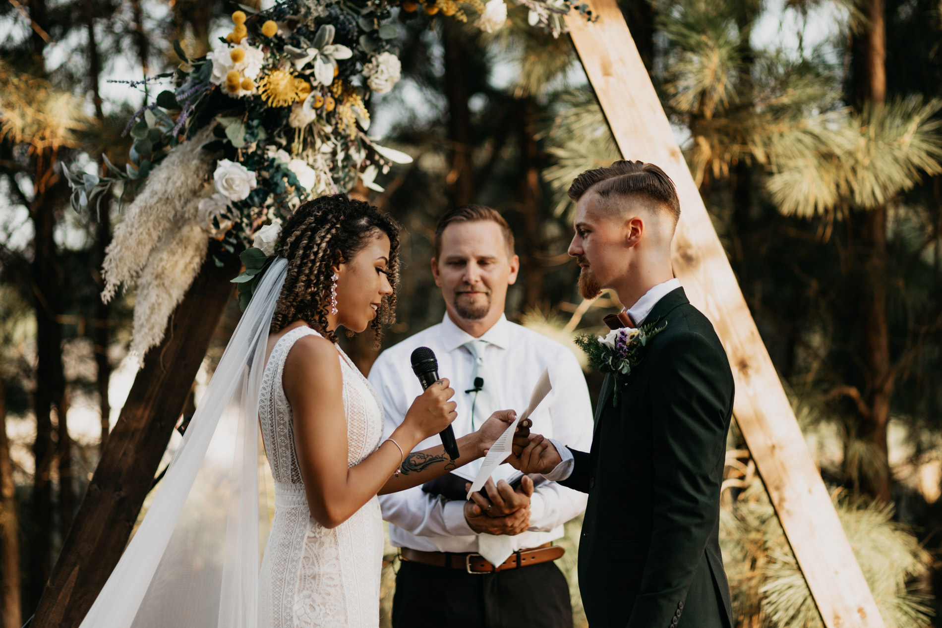 Bride reading vows to groom on wedding day