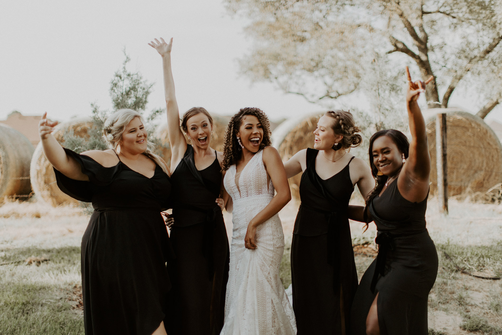 Bride with her bridesmaids on boho wedding day