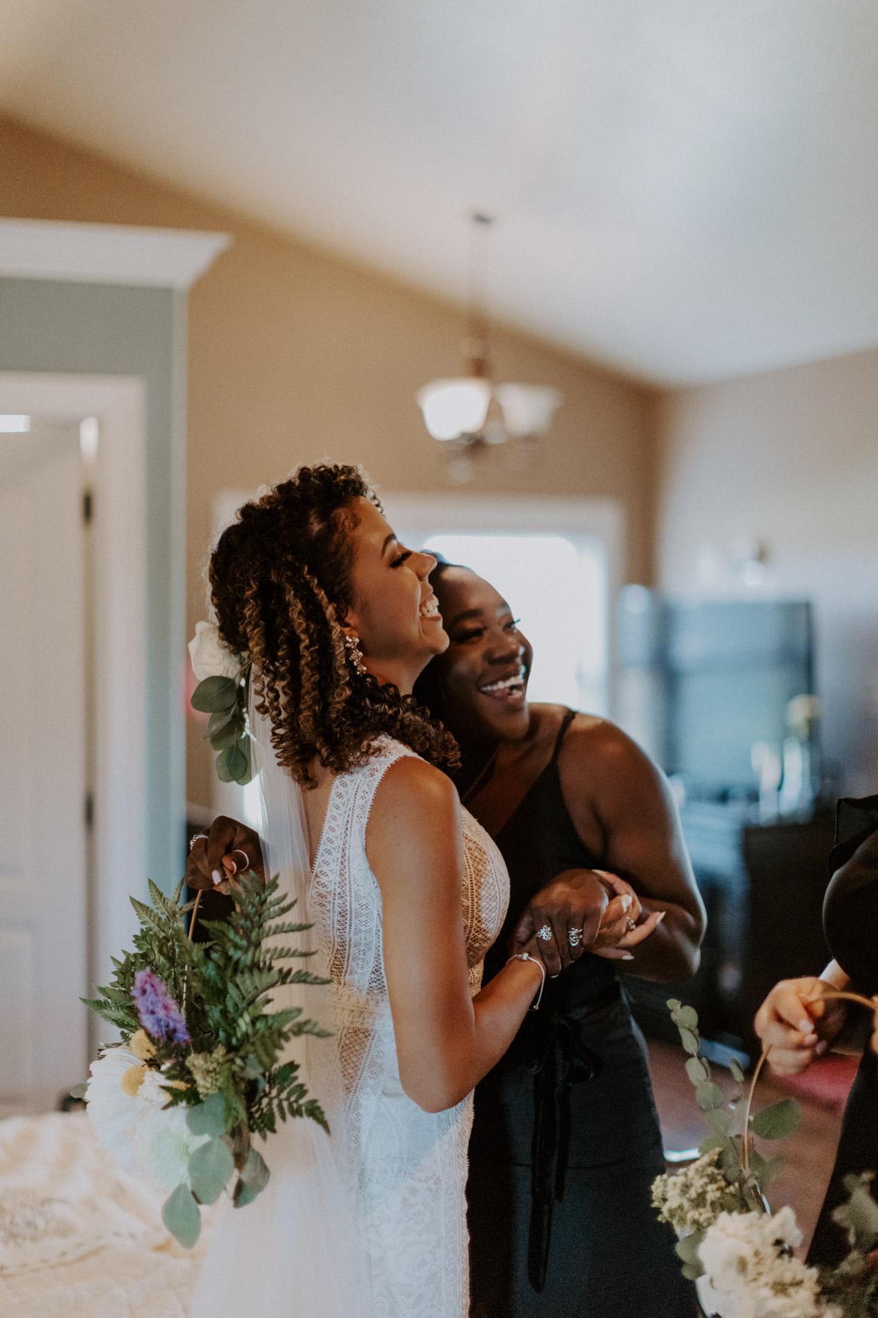 Bride hugging bridesmaid in East Texas before wedding