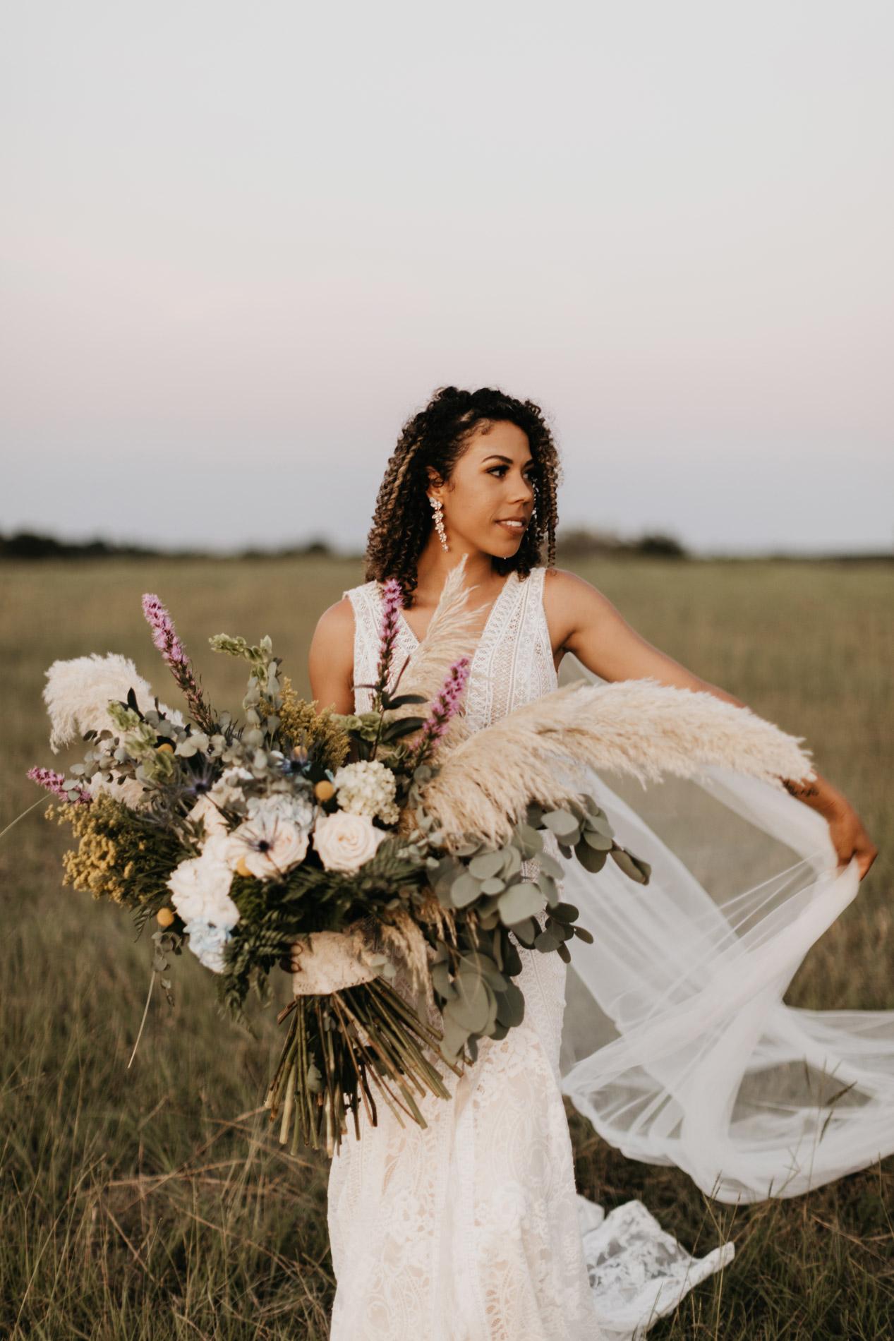 Trendy bride posing on her wedding day