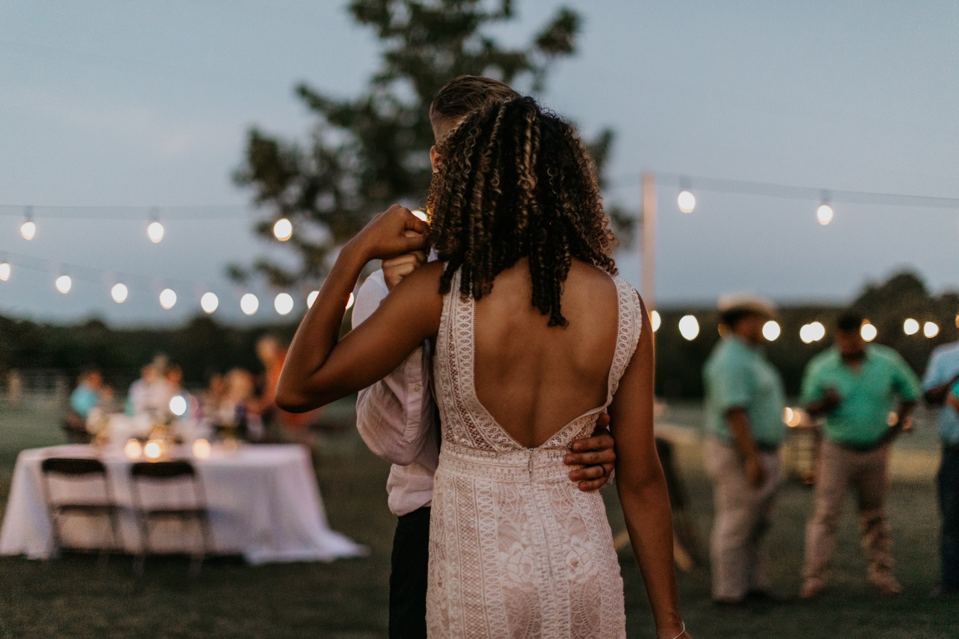 Bride and groom dancing romantically in East Texas on wedding day