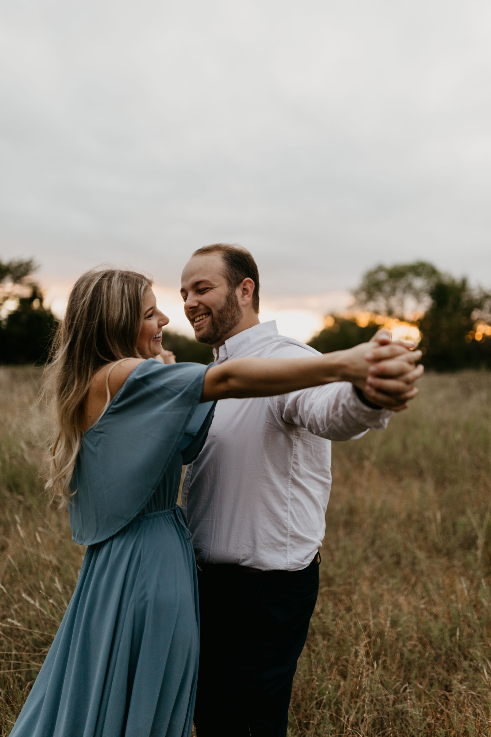 cute couple dancing and being goofy during their fall engagement session in Plano texas