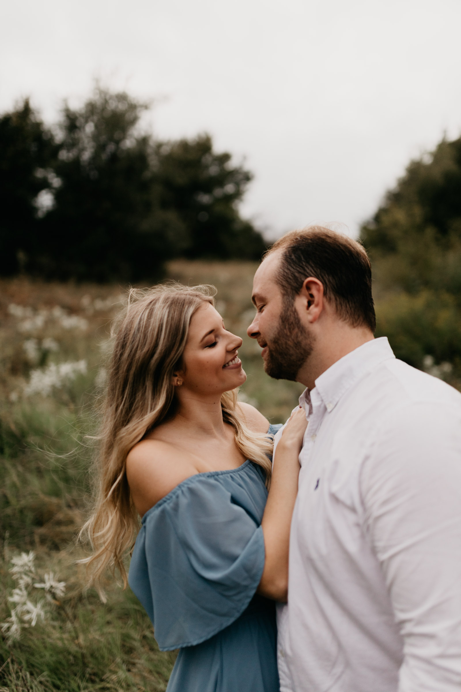 Boy and girl looking at each other during a fall engagement session