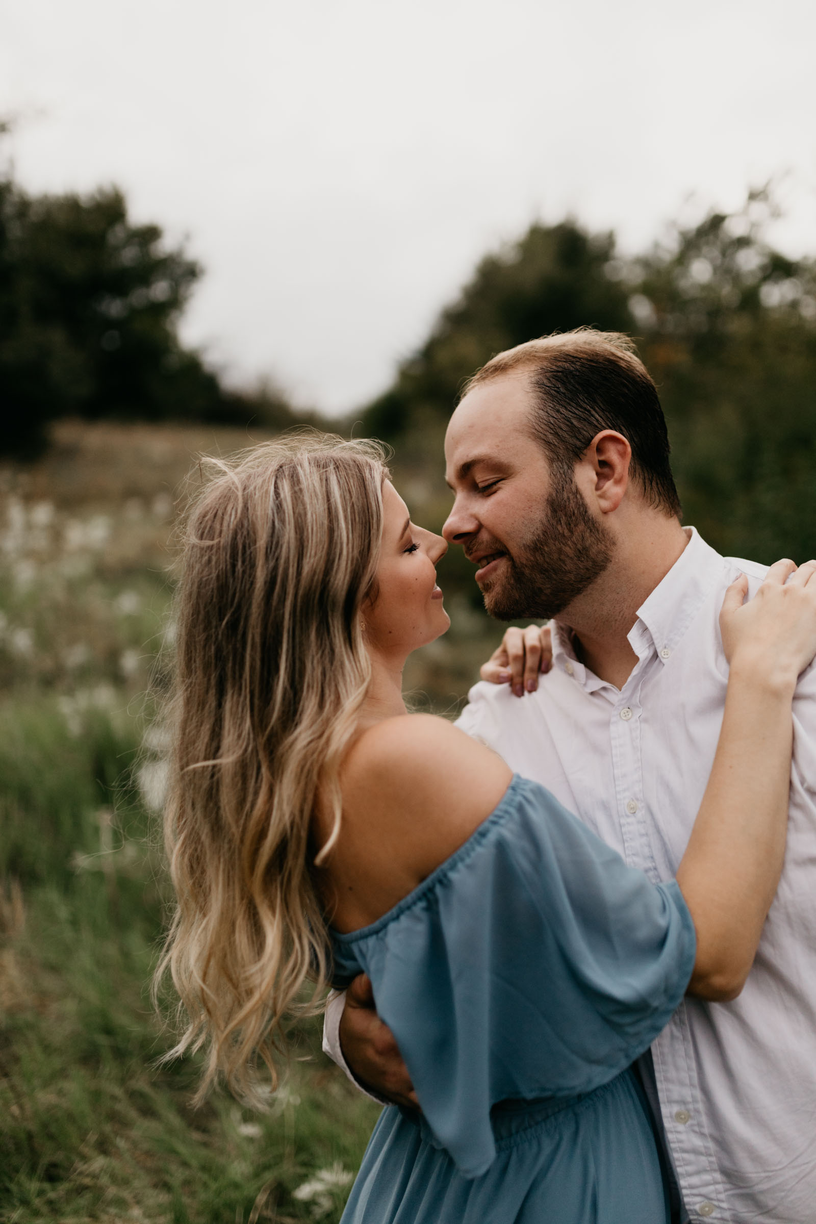 engaged couple about to kiss during their fall photo session